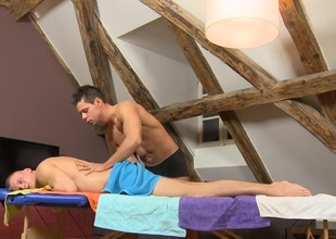 Male masseur is delighting a bulky elated bear
