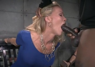 Dungeon blowjobs from a cuffed milf in a grasping dress