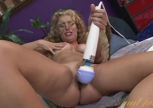 Long curly barb babe gets soaking messy with a toy