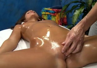 Oiled up Whitney Westgate fucked on a kneading table