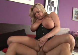 Damn zealous super busty blonde MILF nigh corset rides pretentious dick in the sky top