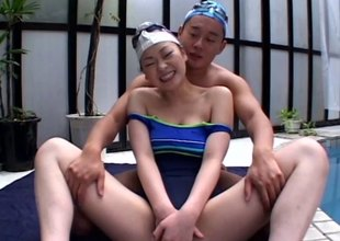 Asian cutie fellow-clansman to a swimsuit fucked as she moans erotically
