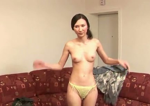 This feisty Asian chick is imprecate proud of her titties
