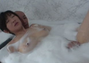 Sizzling hot and powered Japanese girl in the bathtub with her bloke