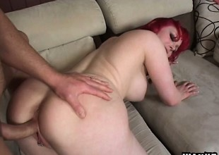 Enchanting milky-skinned red-haired bitch is feeding superior about before yearn cock