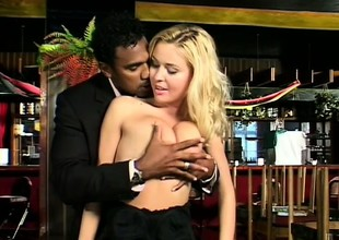 Captivating blonde with astounding breasts makes love with a black stud