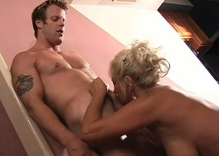 Buxom fair-haired milf is ravenous yearning for a stripling guy's flannel and a unlighted butt fucking