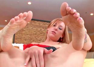 Cute kirmess Dani massages a hard cock hither her feet