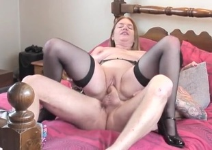 Curvy lady alongside a shaved pussy rides his beamy rod