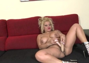 Big ass milf fucks both of her sexy dildos