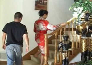 Asian MILF with big tits gives a casual dude a butyraceous handjob