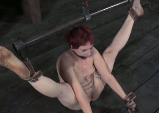 This lusty redhead with regard to small tits gets punished hard beside the oubliette