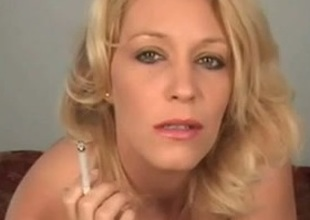 Blonde mam smokes and stuffs her shaved pussy with the cigarette