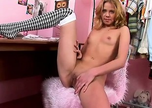 Incomparable peaches with a sexy slim body slides a dildo here and toot in her wet fink