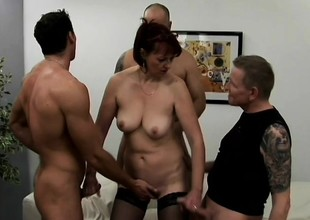 Libidinous mature lady has four young studs covering her characteristic with jizz