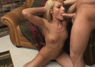 A hellacious blonde gives a sloppy blowjob to a massive rock hard rod