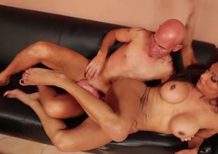 A bald dude with a big dig up is fucking a hot harlot anally
