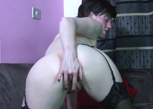Cute unaccompanied milf in stockings rubs her stained cunt