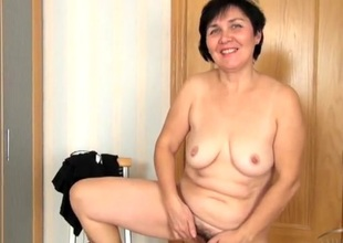 Enjoyment venerable lady masturbates their way hairy chink