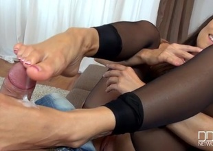 Mea Melone tears honest the brush stockings encircling hither a footjob