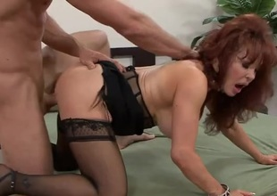 Milf redhead satisfied by a big young locate