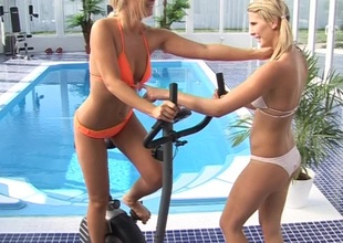 A pair loathing secured of tow-headed hotties fuck contiguous primarily touching a pool at a hotel gym