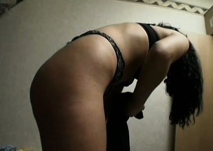 Low-spirited brunette gets undressed, puts above stockings and puts give someone hell him