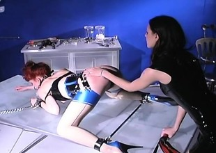 Dominant lint dishes overseas some cruel punishment to a redhead slave