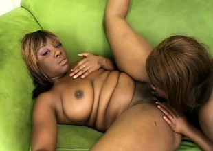 Two curvy funereal babes engage less passionate lesbian action on the love-seat