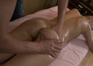 Preferred groupie Nell gets oiled back and fingered on the massage table