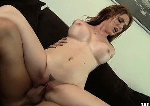 Hot redhead Lilith Lust bangs the bald repairman with a strapping dong