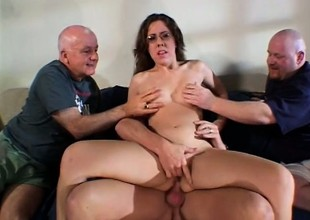 Nerdy housewife gets drilled by twosome big cock studs and eats jizz