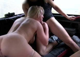 Foursome in a cab cab with amazing busty babes