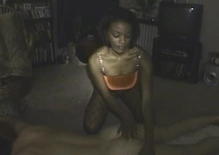 Vivacious ebony cowgirl in a fishnet pantyhose successfully a beamy cock a wicked blowjob