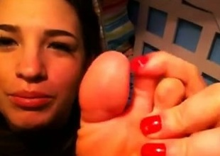 My webcam friend demonstrates her feet and licks her toes