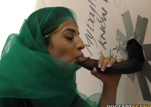 Nadia Ali having lark with black flannel in a gloryhole
