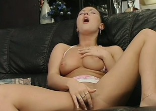 Elegant brunette about perfect boobs makes herself cum hard on the embed