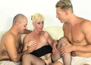 Slutty MILF shows stay away from her dirty talents with two stiff cocks