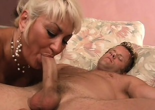 Buxom blonde milf is longing be useful to a young guy's flannel and a deep fucking