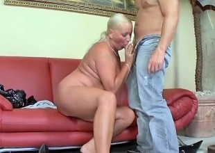 Prurient grown up blonde sucks a long dick and gets her flaming holes pounded hard