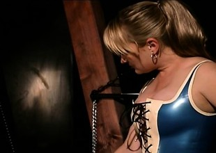 Harmful BDSM slut is completely encased in latex added to played everywhere