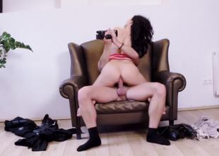 Leather chair is the perfect place to bang a sexy dark-haired cutie