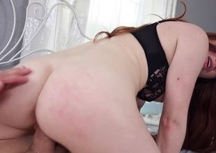 A sexy amateur with red hair gets her lingerie torn off her flesh