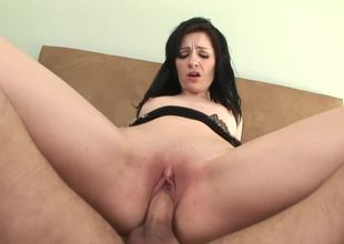 A raven haired girl is getting cumshot near her sexy little mouth