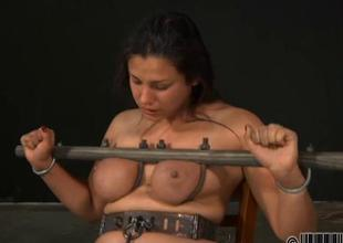 Gagged girl relating involving clamped teats gets shunned amusement