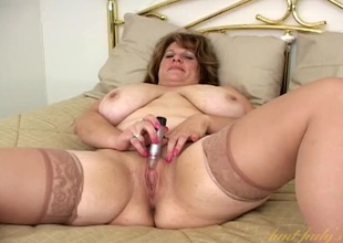 Grown-up BBW nigh satin and stockings masturbates