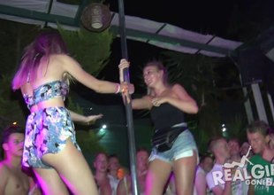 Bold amateur girls overtake stage and dance on a catch pole