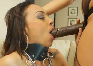 Hot mistress fucks asseverate no to slave back a black strap on dildo