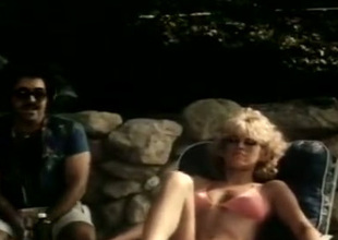 Selected blonde give nice boobies is having sex by rub-down the pool