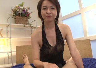 Japanese brunette on tap hand unassuming tits gives skillful handjob